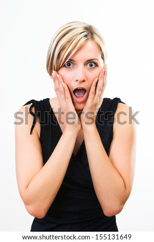 Beautiful young woman showing her surprise  - stock photo