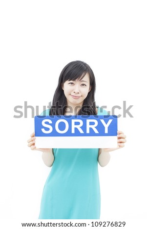 beautiful young woman showing SORRY sign, isolated on white background