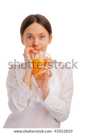 Beautiful young woman sipping juice with a straw on white background - stock photo