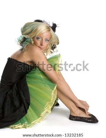 Beautiful young woman sitting in prom dress. White background. - stock photo