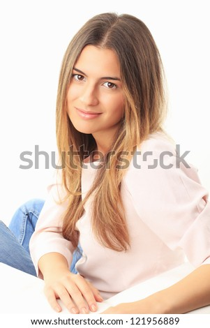 Beautiful young woman sitting on couch