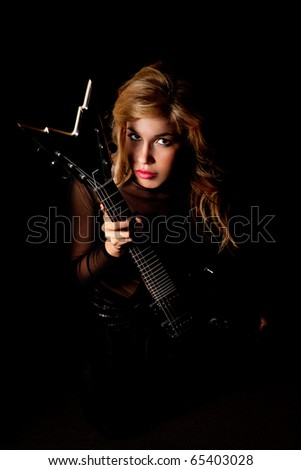 beautiful young woman sitting with a electric guitar