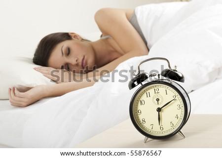 Beautiful young woman sleeping - stock photo