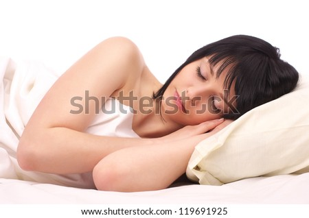 Beautiful young woman sleeping in the bed - stock photo