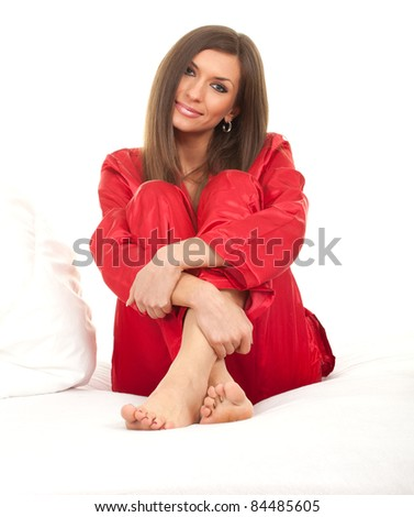 beautiful young woman sleeping in white bedding, series - stock photo