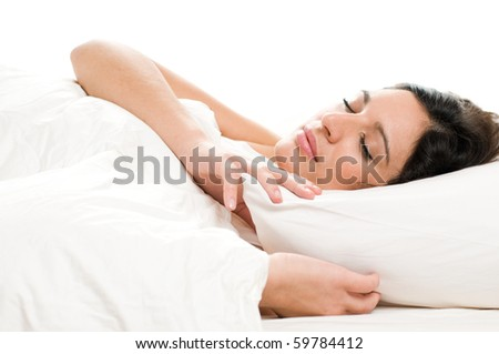 Beautiful young woman sleeping on white isolated