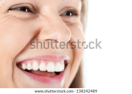 Beautiful young woman smiling and showing bright teeth