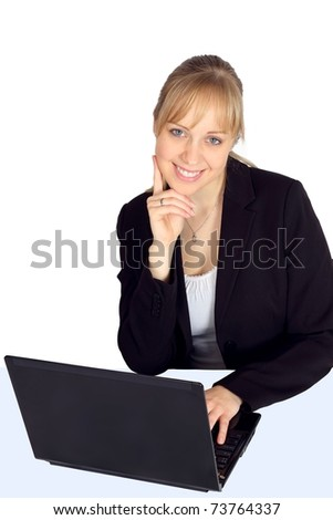 Beautiful young woman smiling by her laptop - stock photo