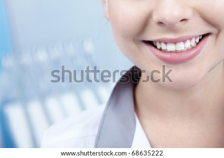 Beautiful young woman smiling closeup - stock photo