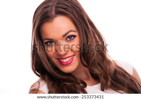 Beautiful young woman smiling, on white background - stock photo
