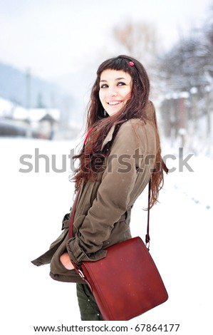 beautiful young woman smiling outside in winter time - stock photo