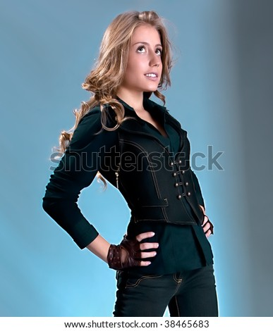 Beautiful young woman  smiling, studio shot - stock photo