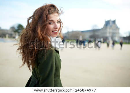 Beautiful young woman smiling. Walking in the city - stock photo