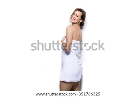beautiful young woman smiling with bath towel on the body - stock photo