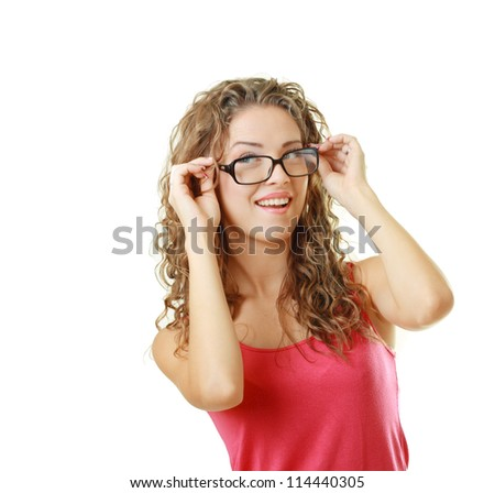 Beautiful young woman smiling with her new pair of eyeglasses isolated on white background - stock photo