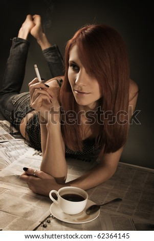 beautiful young woman smoking cigarette - stock photo