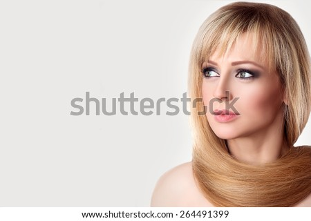 Beautiful Young Woman Spa Portrait. Long Straight Blonde Hair Around the Neck. Eyes with Natural Lases Look sideways. Beauty Face, Fresh Skin.
