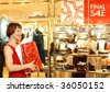 beautiful young woman spend the time in shopping - stock photo