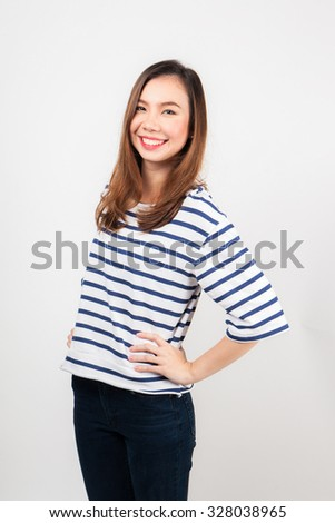 Beautiful young woman standing with white background