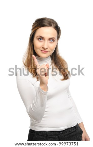 Beautiful young woman stands shaking finger. - stock photo