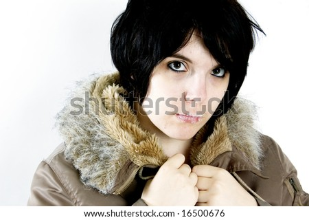 beautiful young woman staring at you little bit anoyed - stock photo
