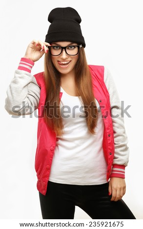 Beautiful young woman sticking out tongue - stock photo