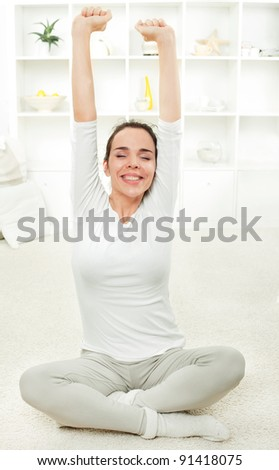Beautiful young woman stretching and feeling happy - stock photo