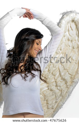 Beautiful young woman stretching angel wings
