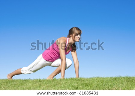 Beautiful Young Woman stretching, getting ready for workout - stock photo