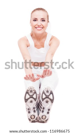 beautiful young woman stretching the muscles of her legs, isolated on white background