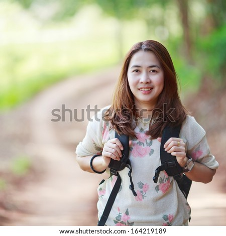 Beautiful  young woman student laughing outdoors - stock photo