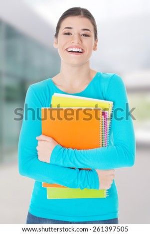 Beautiful young woman student with workbook - stock photo