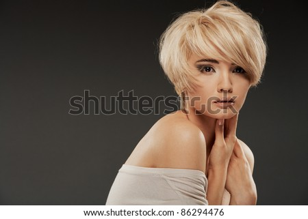 Beautiful young woman studio portrait. Posing adorable model - stock photo