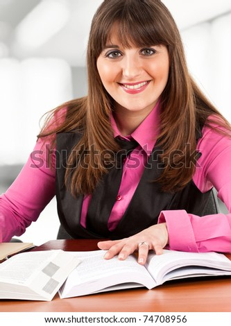 Beautiful young woman studying - stock photo