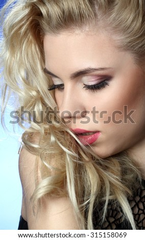beautiful young woman. stylish hairstyle, make-up art. vivid emotions . gorgeous long, wavy Hair