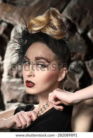 beautiful young woman. stylish hairstyle, make-up art. vivid emotions. retro style. woman with mouthpiece - stock photo