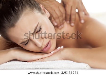 beautiful young woman suffering the unpleasant massage