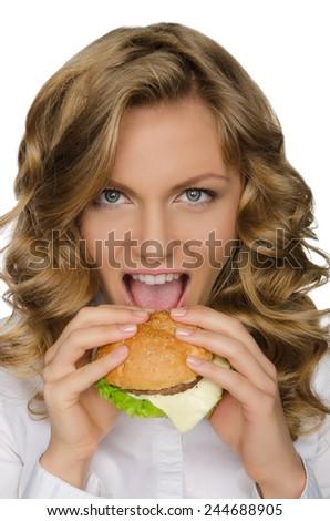 Beautiful young woman taking bite of hamburger isolated on white - stock photo