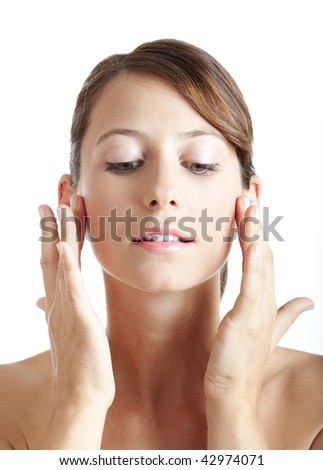 Beautiful young woman taking care of her skin face - stock photo