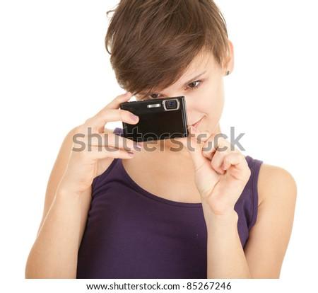 beautiful young woman taking photo, white background - stock photo