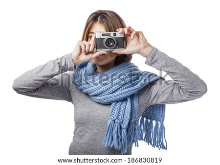 beautiful young woman taking photos with her camera