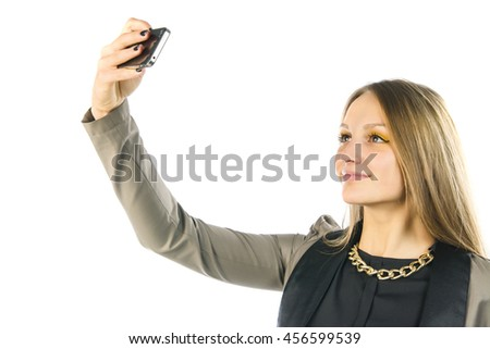 beautiful young woman taking selfie with smartphone, isolated on white background - stock photo
