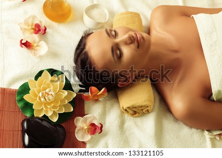 Beautiful young woman taking spa treatments at the salon. - stock photo