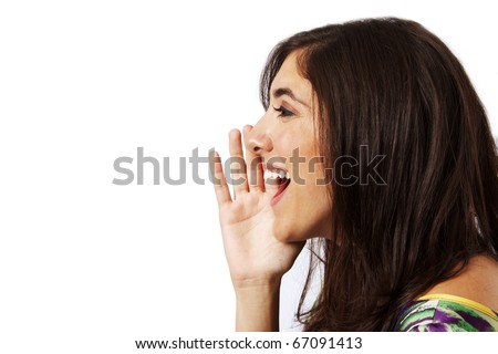 beautiful young woman telling a secret - stock photo