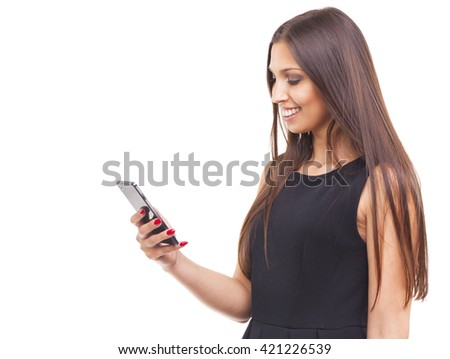 Beautiful young woman texting a message on her smart phone, isolated on white background