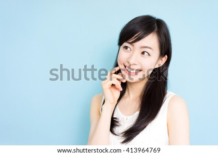 beautiful young woman thinking, isolated on white background - stock photo