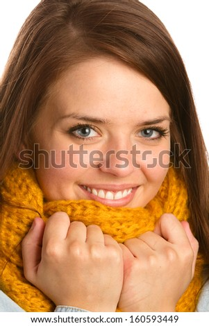 Beautiful Young Woman - This is a photo of a cute young woman wearing a yellow hand knitted scarf. Shot on a white background.