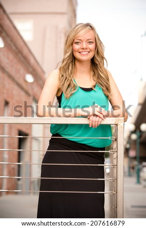 Beautiful Young Woman - This is a shot of a beautiful young woman enjoying the nice summer weather in the city. - stock photo