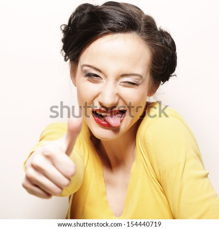 Beautiful young woman touch her up lip by tongue, close up - stock photo