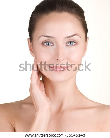Beautiful Young Woman touching her Face - stock photo